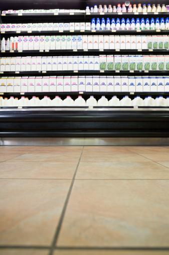 Supermarket「Milk cartons on shelves in supermarket」:スマホ壁紙(18)