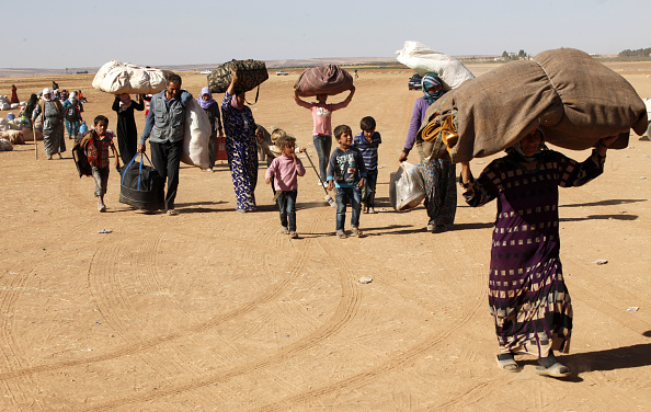 Refugee「Refugees Flee Kobane As IS Forces Battle Kurdish Resistance」:写真・画像(9)[壁紙.com]
