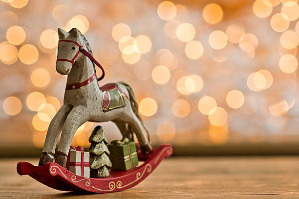 Christmas rocking horse in front of points of light:スマホ壁紙(壁紙.com)