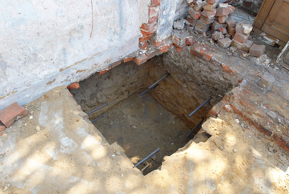 Construction Material「Subsidence repair, hole to be filled with concrete to prevent further subsidence, elevated view」:写真・画像(19)[壁紙.com]