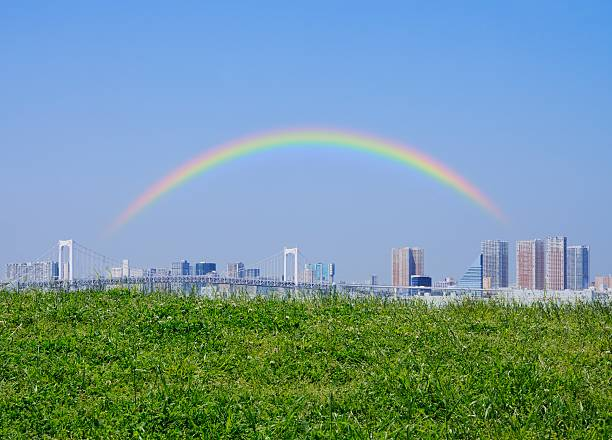 View over field of Ariake, and a rainbow over the city. Koto Ward, Tokyo Prefecture, Japan:スマホ壁紙(壁紙.com)