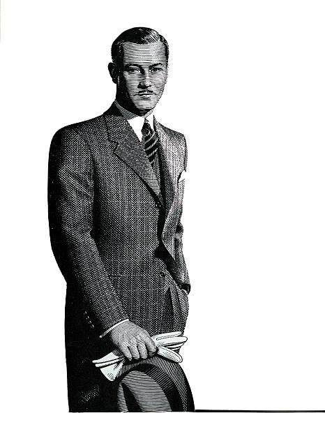 Suave Businessman In Suit:ニュース(壁紙.com)