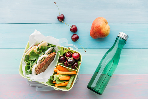 Lunch Box「Healthy school food in a lunch box, vegetarian sandwich with cheese, lettuce, cucumber, egg and cress, sliced carrot and celery, cherries and pear」:スマホ壁紙(6)
