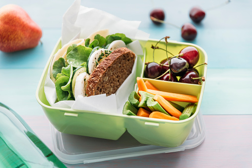Celery「Healthy school food in a lunch box, vegetarian sandwich with cheese, lettuce, cucumber, egg and cress, sliced carrot and celery, cherries and pear」:スマホ壁紙(2)