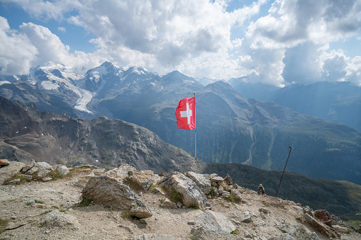 Engadine「Swiss flag on top of Beautiful mountain landscape in the Swiss Alps in Graubunden Canton」:スマホ壁紙(2)