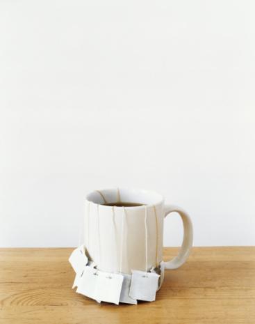 Emotional Stress「Tea bags in mug on table」:スマホ壁紙(16)
