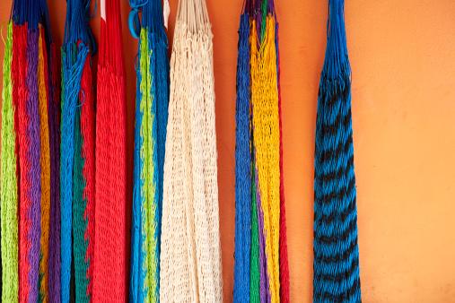Hammock「Colorful Hammocks Hang on Orange Stucco Wall, Mexico」:スマホ壁紙(4)