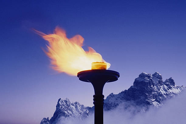 Snow-covered mountains behind flaming torch (Digital Composite):スマホ壁紙(壁紙.com)