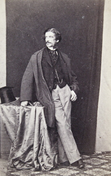 Profile View「Lord In Half Profile In A Dark Frock Coat; Dark Skirt And Bright Pants; Cylinder On An Atelier Table. Full Figure. About 1865. Anonymous Photograph.」:写真・画像(2)[壁紙.com]