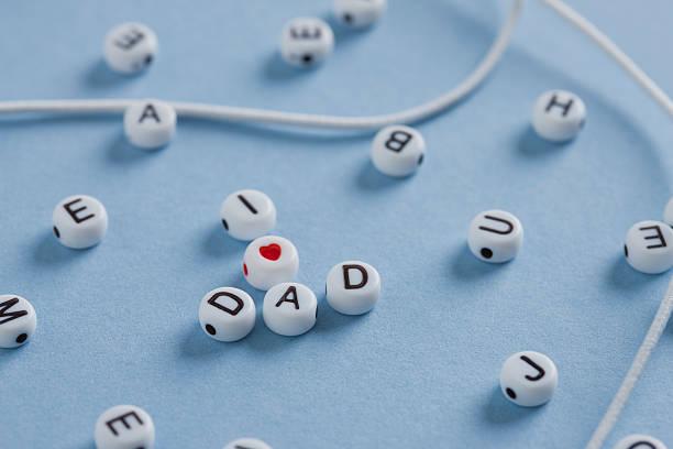 PLastic letters forming word dad on blue background:スマホ壁紙(壁紙.com)