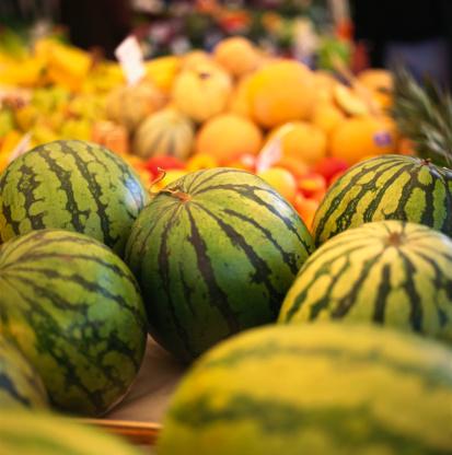 スイカ「Several water melons on a fruit stall at the market」:スマホ壁紙(15)