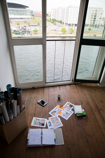 Funky「Files and digital tablet lying on floor of bright office」:スマホ壁紙(5)