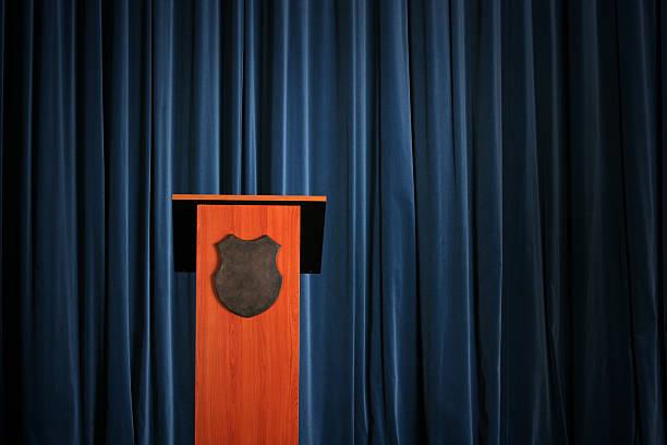 Empty press conference room with a wooden podium:スマホ壁紙(壁紙.com)