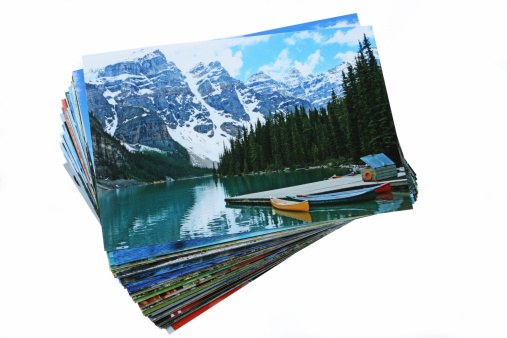 Moraine Lake「Stack of Printed Vacation Photographs on White Background」:スマホ壁紙(18)