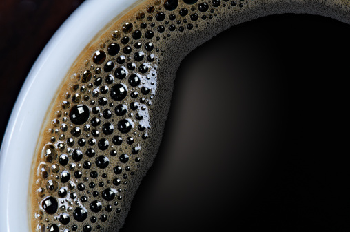 Coffee - Drink「A closeup shot of a cup of black coffee with tiny bubbles 」:スマホ壁紙(9)