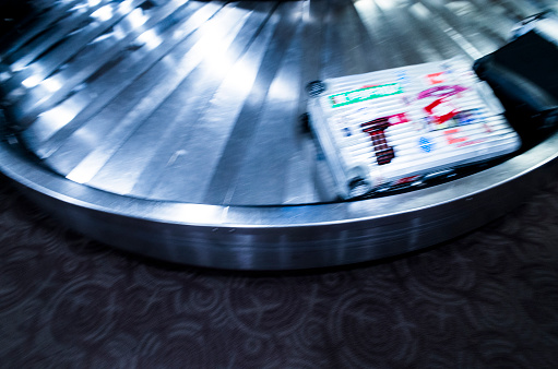 Passenger「baggage Roller bag flowing with carousel.」:スマホ壁紙(7)