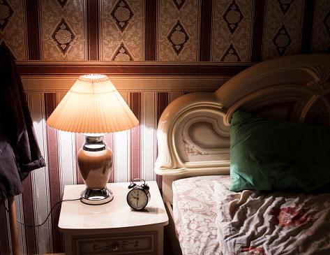Pillow「Lamp on bedside table in bedroom」:スマホ壁紙(9)