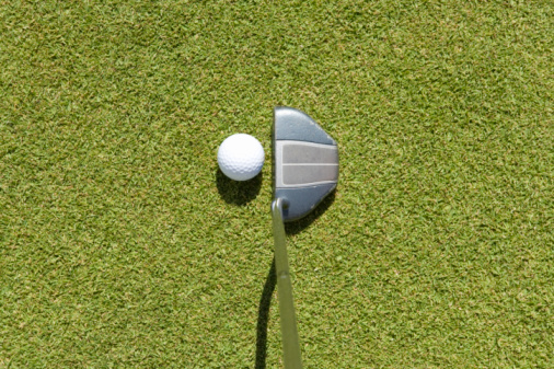 Northern Mariana Islands「Golf club hitting ball on grass, Saipan, USA 」:スマホ壁紙(1)