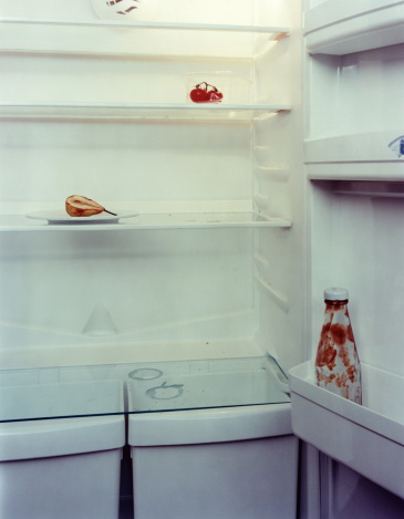 Condiment「Refrigerator with empty ketchup bottle and old pear, close-up」:スマホ壁紙(6)