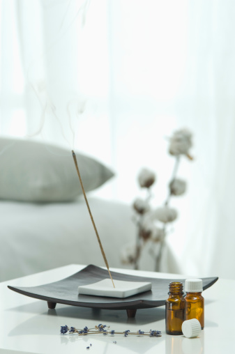 Incense「Aroma sticks with aroma oil and lavender flower on table, close up」:スマホ壁紙(0)
