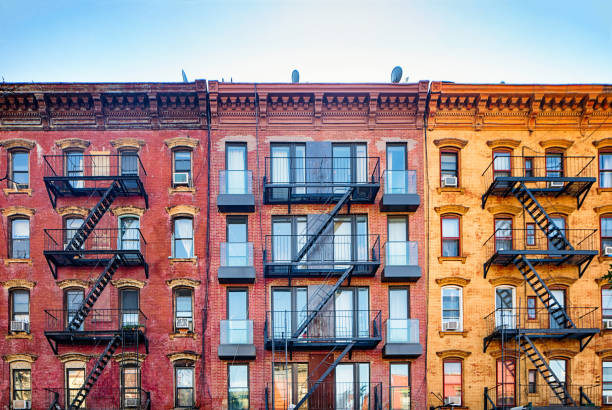 Top stories of colorful Williamsburg apartment buildings with steel fire escape stairways:スマホ壁紙(壁紙.com)