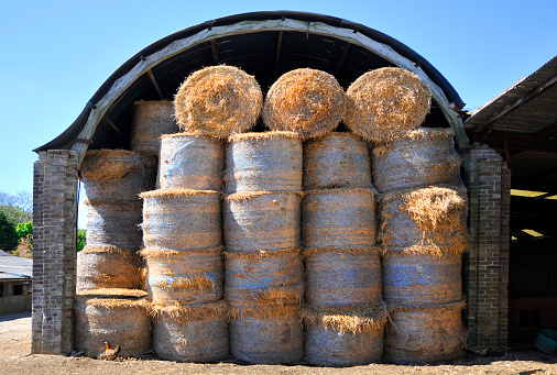 Isle of Man「Hay bales stacked and stored in a Farm Barn」:スマホ壁紙(4)
