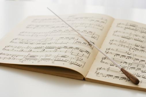 Musical Conductor「Conductor's baton on sheet music」:スマホ壁紙(0)