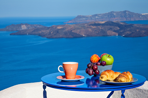 Aegean Sea「Breakfast with croissants and fresh fruit at early morning served on the balcony with sea volcanic view.」:スマホ壁紙(9)