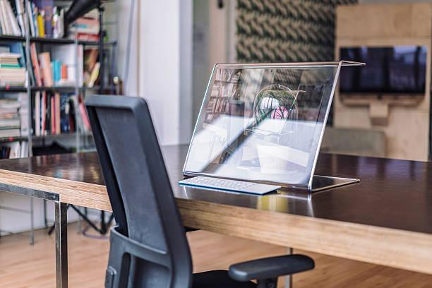 Futuristic computer on desk in creative office:スマホ壁紙(壁紙.com)