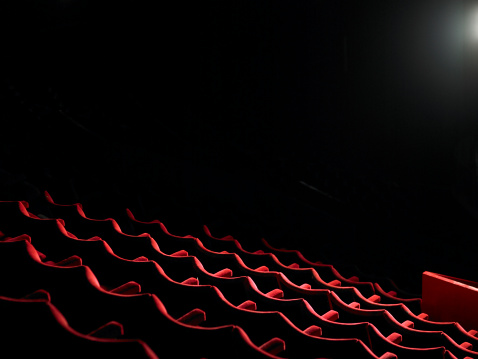 Arts Culture and Entertainment「Rows of empty red cinema seats」:スマホ壁紙(14)