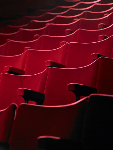 Arts Culture and Entertainment「Rows of empty red cinema seats」:スマホ壁紙(10)