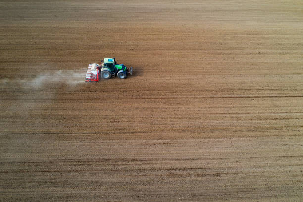 Tractor with seed drill seeding crops at field, aerial view:スマホ壁紙(壁紙.com)