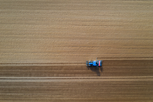 Plowed Field「Tractor with seed drill at field, aerial view」:スマホ壁紙(12)