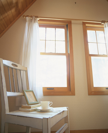 Low Angle View「White wooden chair in attic room by window」:スマホ壁紙(10)