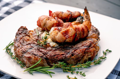 Char-Grilled「Char-Grilled Ribeye Steak with Thyme and Rosemary with Bacon-Wrapped Jumbo Shrimp or Prawns on a Plate, Ready to Eat」:スマホ壁紙(13)