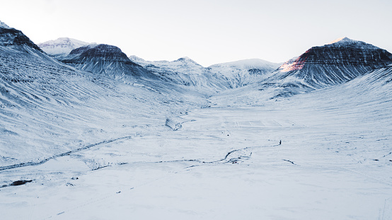 Iceland「Aerial view of beautiful winter road and mountains during sunset in North Iceland」:スマホ壁紙(15)