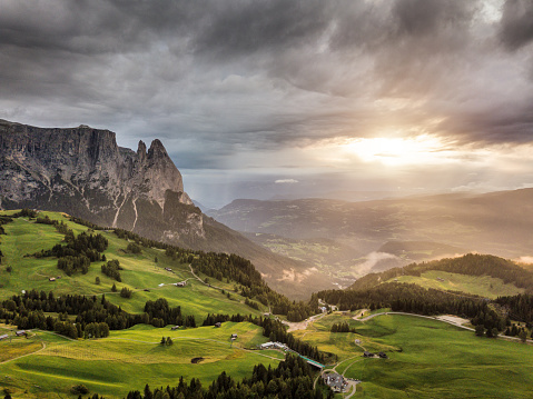 Siusi「Aerial view of Sciliar mountains with sunlight and dramatic sky - Dolomites」:スマホ壁紙(17)