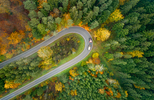 Hairpin Curve「Aerial view of hairpin curve  through a forest in autumn」:スマホ壁紙(10)