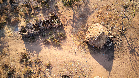 UNESCO「Aerial view of a straw hut with fence to protect the fruits storage in Angola」:スマホ壁紙(9)