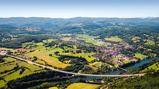 Ain - France「Aerial view of beautiful french countryside with elevated highway small village and beginning of Alps mountains in background」:スマホ壁紙(2)