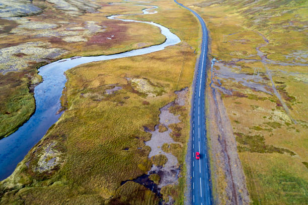 Aerial View of Red Car Driving on Road in Iceland:スマホ壁紙(壁紙.com)