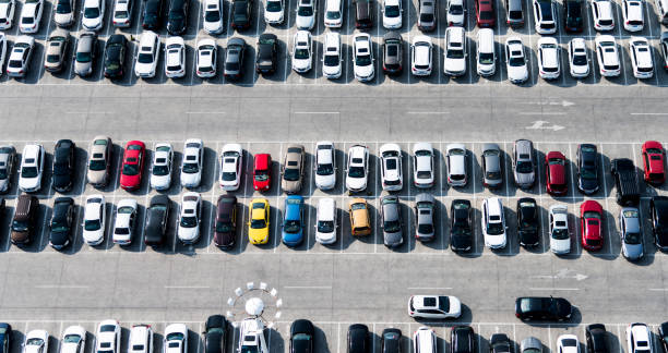 Aerial view of cars in a parking lot:スマホ壁紙(壁紙.com)