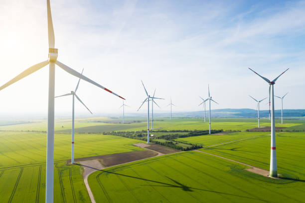 Aerial view of wind turbines and agriculture field:スマホ壁紙(壁紙.com)