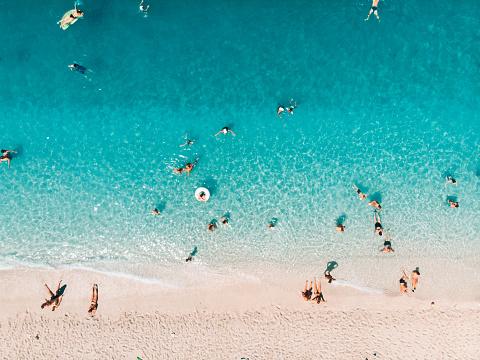 Mediterranean Sea「Aerial view of people at the beach,Ionian Islands, Greece」:スマホ壁紙(1)