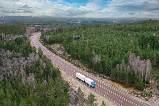 Boreal Forest「Aerial view of a truck on a highway through a forest landscape」:スマホ壁紙(18)
