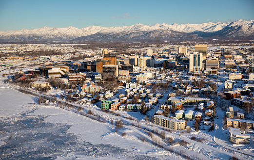 Anchorage - Alaska「Aerial view of snow covering the sea ice on the frozen shores of downtown Anchorage, the Chugach Mountains in the distance beyond the office buildings and hotels, Cook Inlet in the foreground, South-central Alaska in winter」:スマホ壁紙(7)