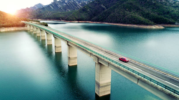 Aerial View of road above a lake:スマホ壁紙(壁紙.com)
