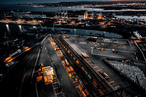 Global Finance「Aerial view of the New Jersey Shipyard with numerous cranes, gantries and shipping containers, captured at golden hour」:スマホ壁紙(14)