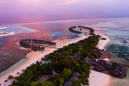 South Male Atoll「Aerial view of stilt houses at Olhuveli island during sunrise, Maldives」:スマホ壁紙(17)