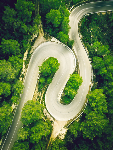 Hairpin Curve「Aerial view of a two lane winding road in a forest」:スマホ壁紙(3)